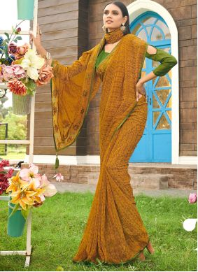 Abstract Print Faux Georgette Saree in Mustard