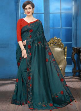 Engrossing Embroidered Teal Silk Saree