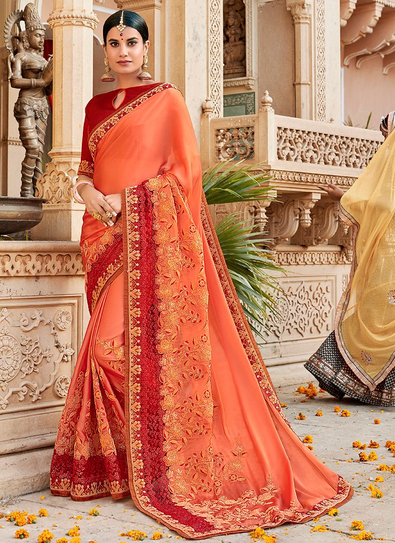 Entrancing Faux Georgette Peach Traditional Saree