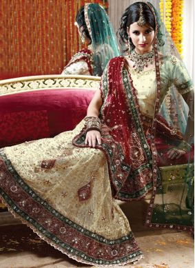 Entrancing Net Cream Fancy Lehenga Choli
