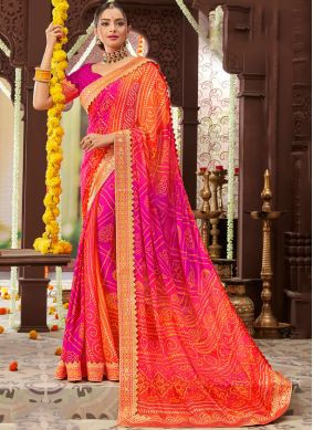 Prominent Printed Faux Chiffon Orange and Pink Traditional Saree