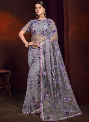 Thrilling Net Purple Embroidered Saree